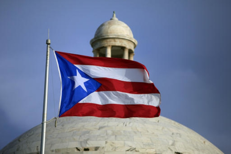 The Puerto Rican flag flies in front of Puerto Rico's Capitol in San Juan, Puerto Rico.