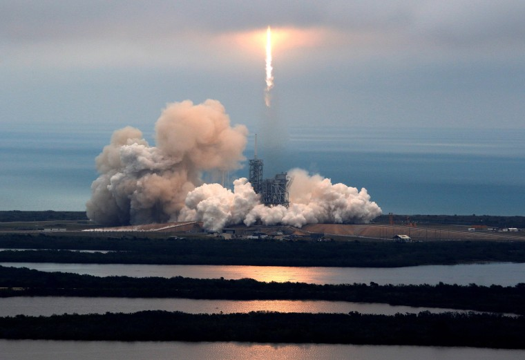 Image: A SpaceX Falcon 9 rocket disappears into clouds after it lifted off on a supply mission to the International Space Station from historic launch pad 39A at the Kennedy Space Center in Cape Canaveral
