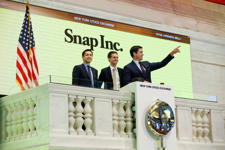 Image: Snap co-founders Evan Spiegel and Bobby Murphy ring the opening bell of the New York Stock Exchange
