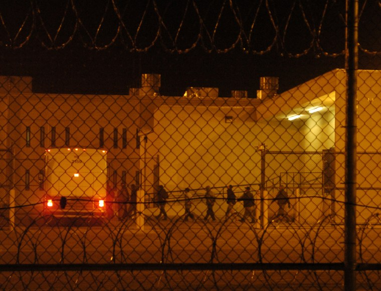 DEL RIO TEXAS DEC. 12, 2006-- Migrants load onto a bus early in the morning, Tuesday, Dec. 12, 2006, at the Val Verde Correctional Facility in Del Rio, Texas. The migrant inmates were en route to courthouse in Del Rio where they would face their charges.