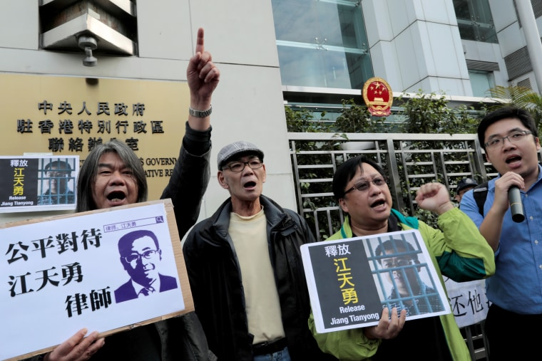 Image: Pro-democracy demonstrators hold up portraits of Chinese disbarred lawyer Jiang Tianyong, demanding his release, during a demonstration outside the Chinese liaison office in Hong Kong, China, Dec. 23, 2016.