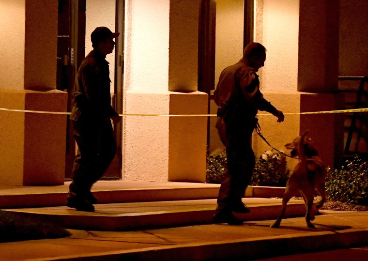Image: Las Vegas Metropolitan Police Department K-9 officers search the Jewish Community Center of Southern Nevada after an employee received a suspicious phone call that led about 10 people to evacuate the building on Feb. 27, 2017.