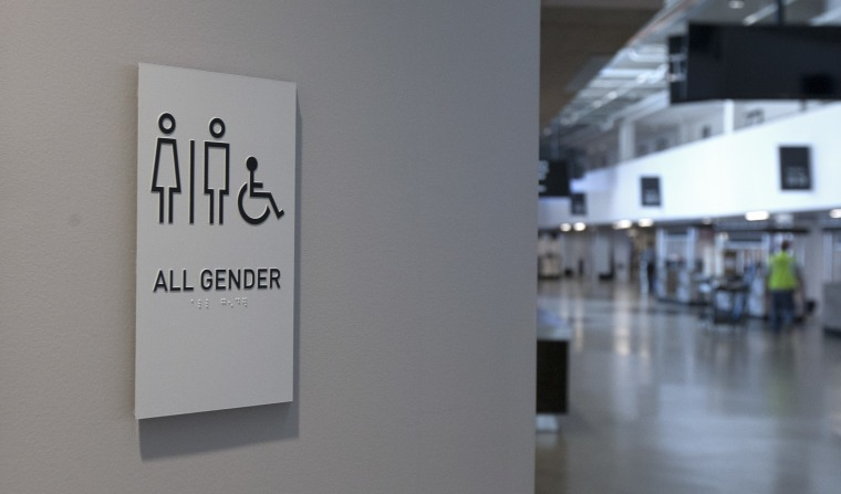 A sign marking an all-gender restroom is seen at the new Golden 1 Center, Thursday, Sept. 29, 2016, in Sacramento, Calif.