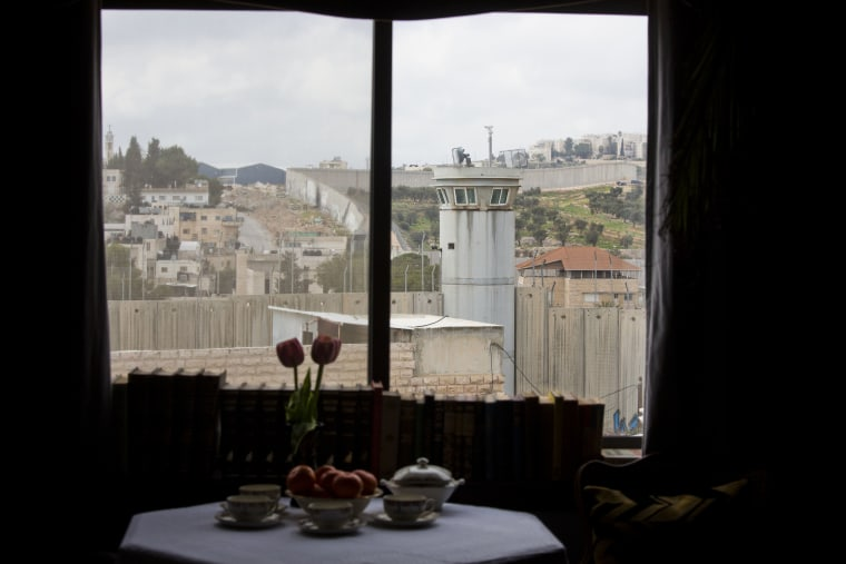 "Image: An Israeli security watch tower is seen from one of the rooms of the ""The Walled Off Hotel"" in the West Bank city of Bethlehem, Friday, March 3, 2017."