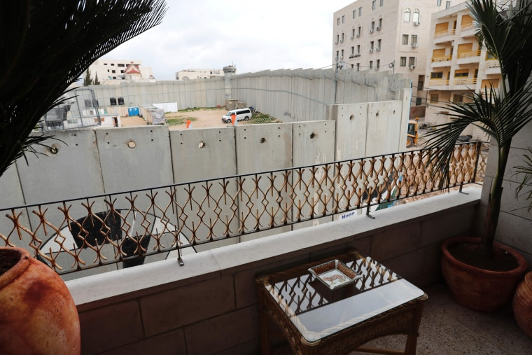 "Image: A picture taken from the street artist's newly opened ""hotel"" shows Israel's controversial separation wall."