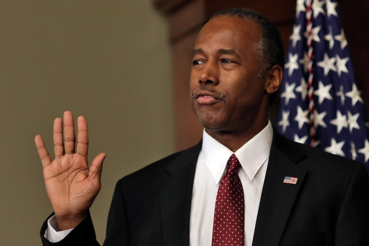 Image: New secretary of the Department of Housing and Urban Ben Carson is sworn in by U.S. Vice President Mike Pence at the Executive Office in Washington, U.S.
