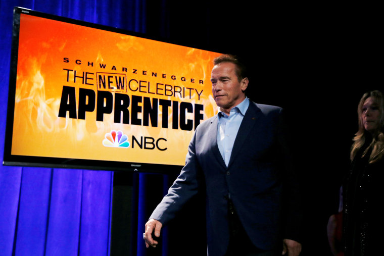 """Image: Host Arnold Schwarzenegger walks on stage to participate in a panel for \""""The New Celebrity Apprentice\"""" in Universal City, California, Dec. 9, 2016."""