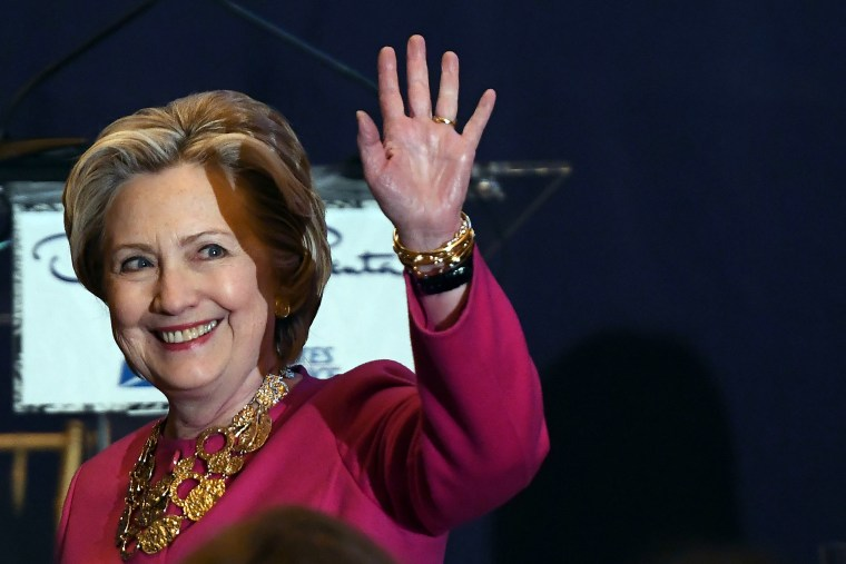 Image: Former U.S. Secretary of State and Democratic presidential nominee Hillary Clinton waves as she arrives to unveil U.S. postal service issued Oscar de la Renta Forever stamp during a ceremony in New York on Feb.16, 2017.
