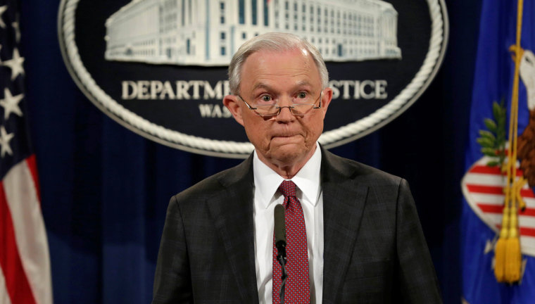Image: U.S. Attorney General Jeff Sessions pauses at a news conference at the Justice Department in Washington