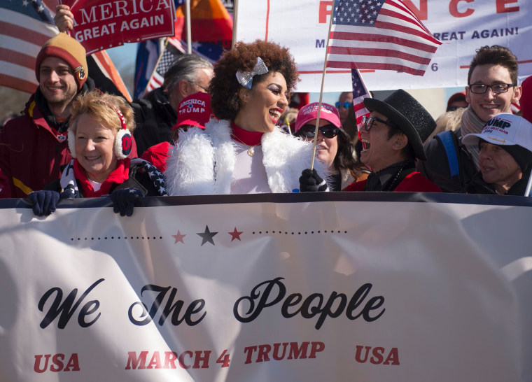 Image: Singer Joy Villa, center, and designer Andre Soriano take part in a pro-Trump rally outside the Washington Monument on March 4, 2017, in Washington, DC.