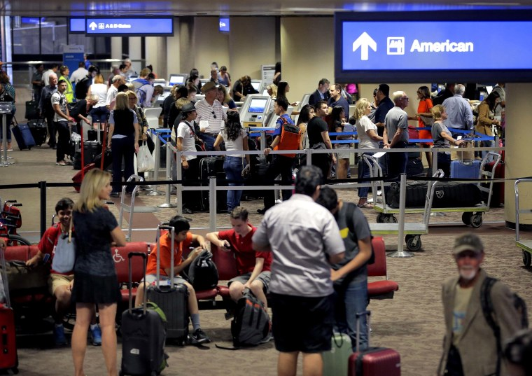 In this May 27, 2016 file photo, passengers line up to check in before their flight at Sky Harbor International Airport in Phoenix.