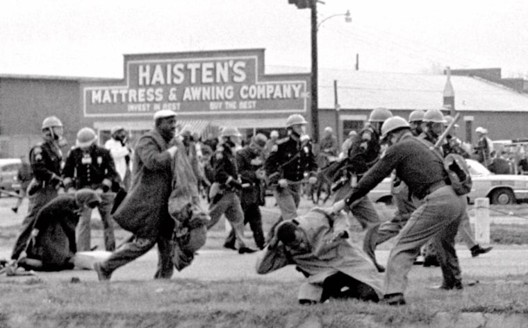Image: Alabama state troopers swing nightsticks to break up a civil rights voting march in Selma, Alabama, March 7, 1965.