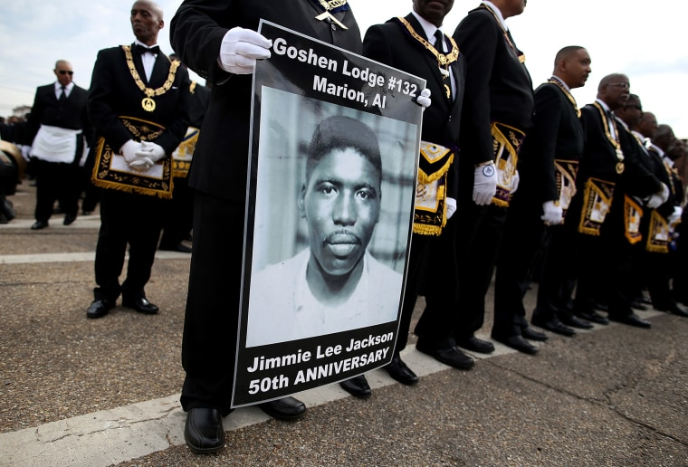 Image: A marcher holds a poster of Jimmie Lee Jackson, a civil rights activist who was beaten and shot by Alabama State troopers in 1965, during the 50th anniversary commemoration of the Selma to Montgomery civil rights march on March 8, 2015 in Selma.