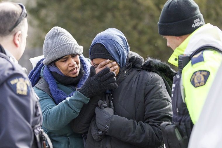 Image: The two women became emotional while being detained.