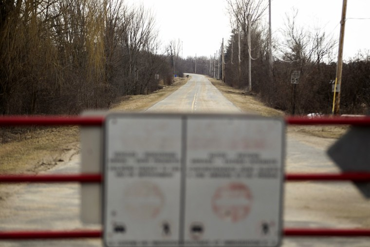 Image: A gate blocks access to Meridian Road leading to Champlain, New York from the Canadian side of the Canada-U.S. border, Feb. 27, 2017.