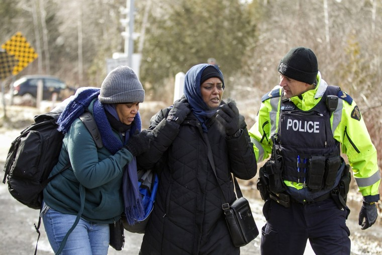 Image: An RCMP officer speaks with the women.
