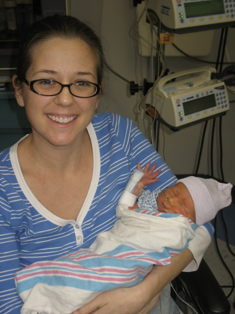 Heather Barrow, founder of High Risk Hope, holds her premature son in the NICU at St. Joseph's Women's Hospital in Florida in 2011.