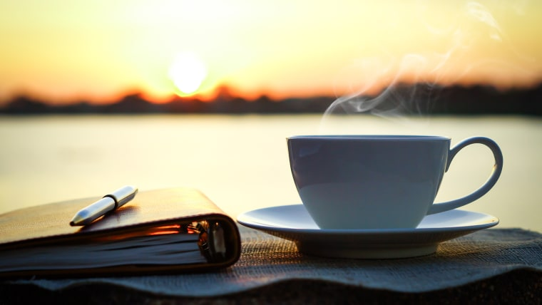 coffee cup at sunrise