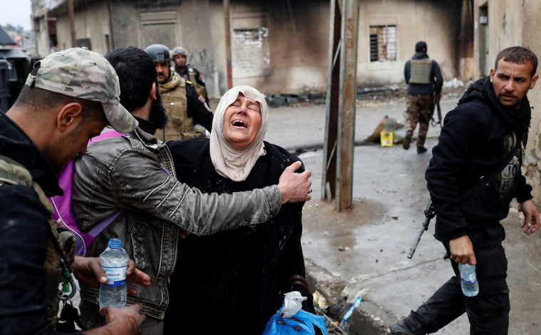 Image: A woman cries after crossing from Islamic State controlled part of Mosul to Iraqi forces controlled part of Mosul