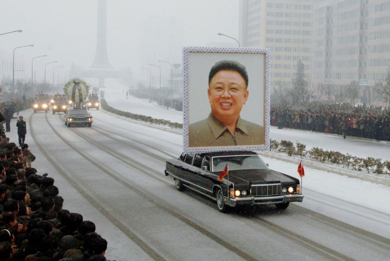 Image: A portrait of late North Korean leader Kim Jong Il is carried past mourners during his funeral procession through the streets of Pyongyang, North Korea on Dec. 28, 2011.