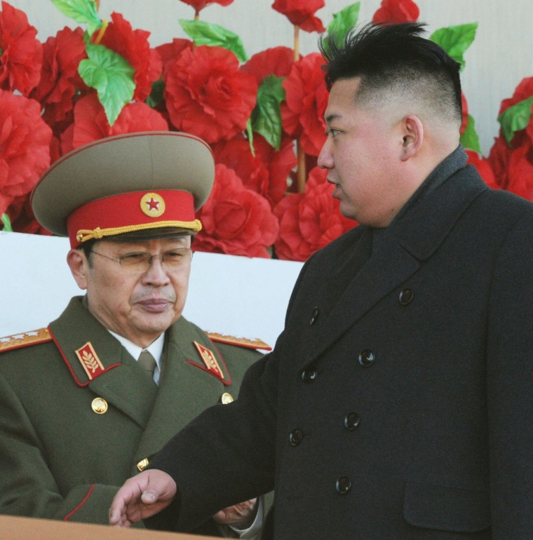 Image: North Korean leader Kim Jong-un walks past his uncle, North Korean politician Jang Song Thaek, during a military parade in Pyongyang on Feb. 16, 2012.