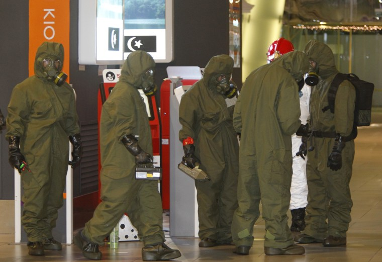 Image: Hazmat crews gather at the main hall of Kuala Lumpur International Airport 2 in Sepang, Malaysia on Sunday, Feb. 26, 2017.