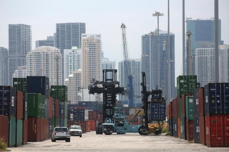 A mule truck moves a container in the Port of Miami in Miami