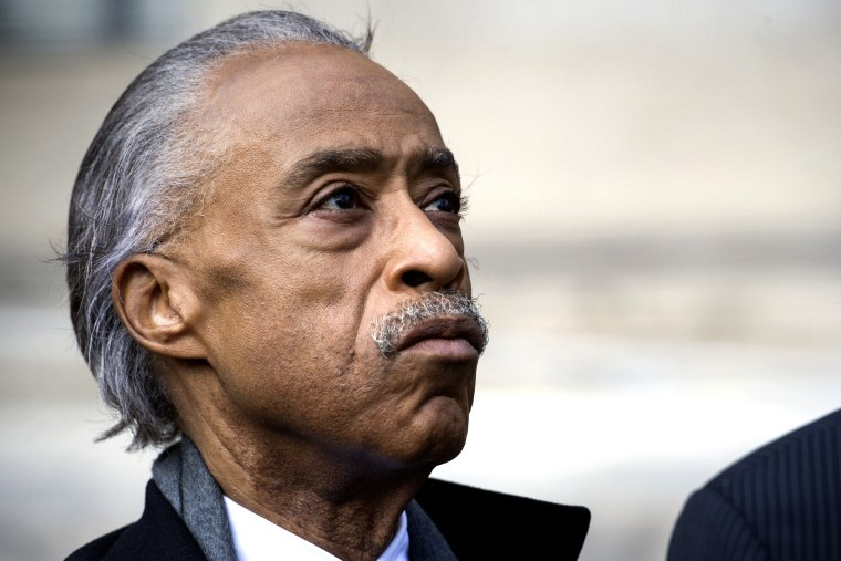 Image: Rev. Al Sharpton, founder of National Action Network, looks up while speaking with the news media