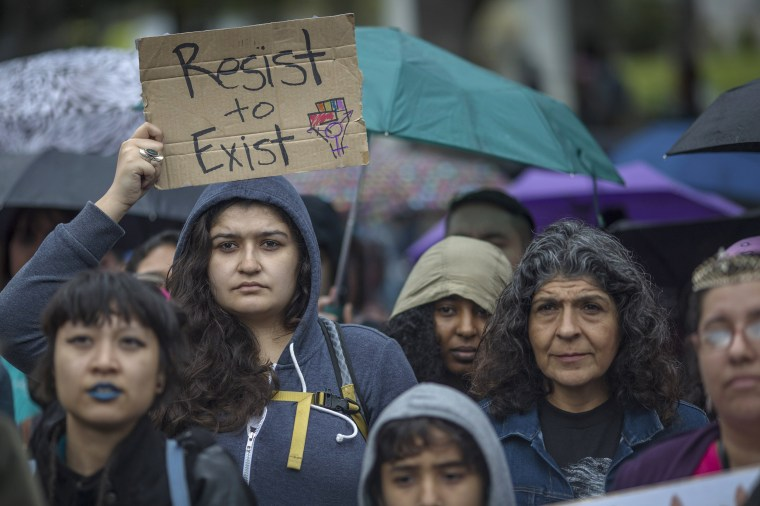Image: Women listen to a speaker during the International Women's Day March and Rally