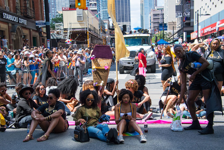 Members of Black Lives Matter sit and block the Toronto Pride Parade from the normal parade route on July 3, 2016.