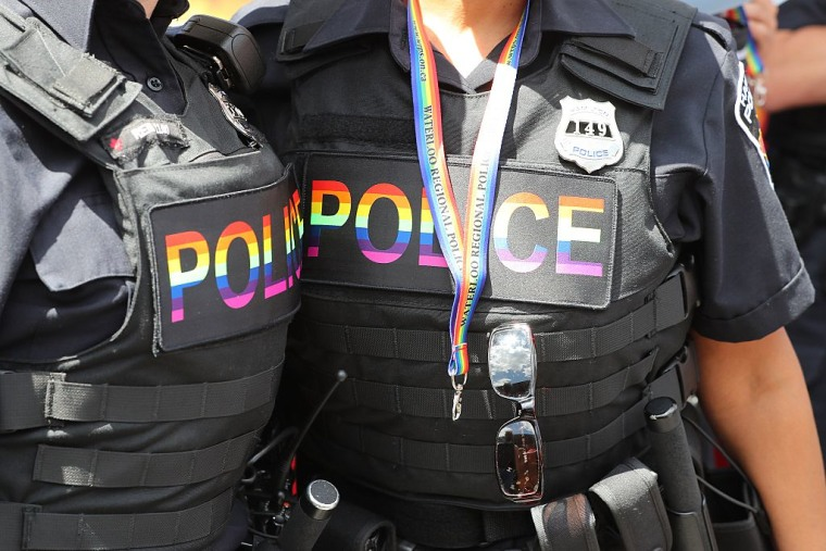 Police sport rainbow police flashes on their vests during the 2016 Toronto Pride parade.