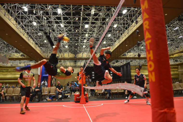 Sepak Takraw of USA's White Dragon Team from Minnesota, wearing black, playing against a Karen-American team from Phoenix, Arizona in red at the Skillcon Sepaktakraw Open in Las Vegas, December 2016.