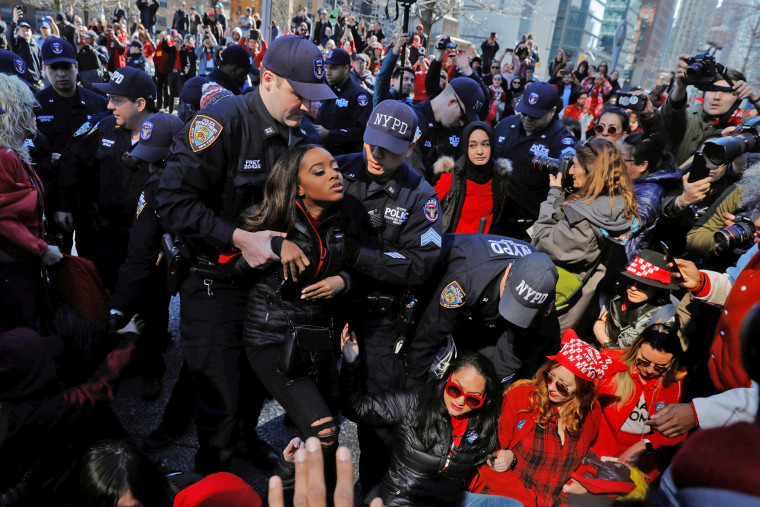 Image: New York Police Department officers arrest women taking part in a Women's Day Rally in New York
