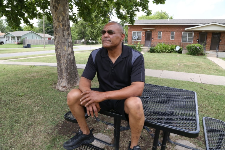 Image: Thomas Webb sits at a table he uses as a meditation area outside his home in Oklahoma City