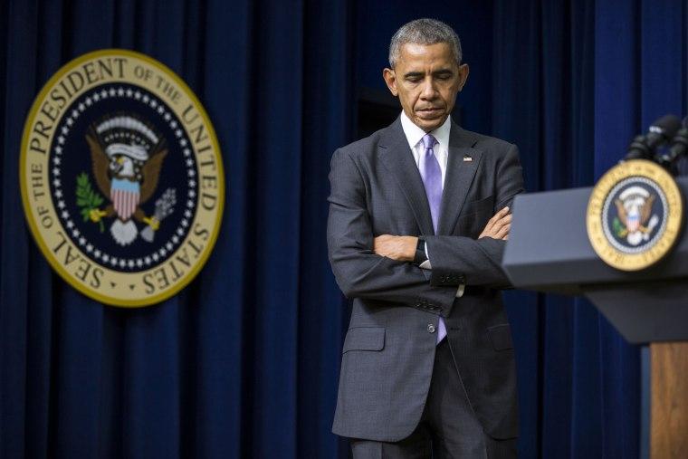 Image: President Barack Obama listens as Vice President Joe Biden spoke at a bill signing in Washington.