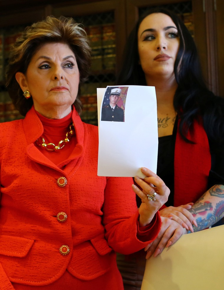 Image: Attorney Gloria Allred holds photograph with U.S. marine Erika Butner