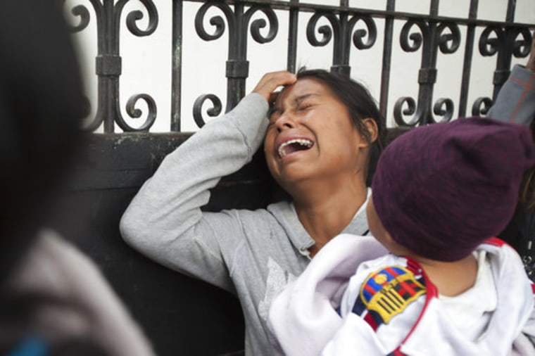 A relative of a youth who resided at the Virgin of the Assumption Safe Home wails as she waits for the release of the names of those who died in a fire at the shelter, outside the morgue where the bodies are being identified in Guatemala City, Thursday, March 9, 2017.