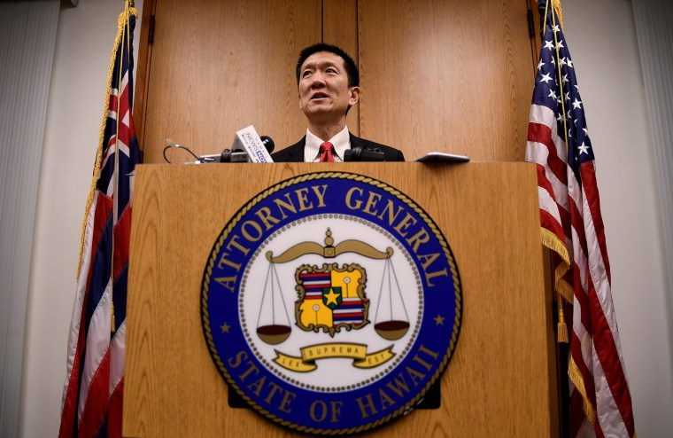 Image: Hawaii Attorney General Douglas Chin speaks at a press conference after filing an amended lawsuit against President Donald Trump's new travel ban in Honolulu, Hawaii.