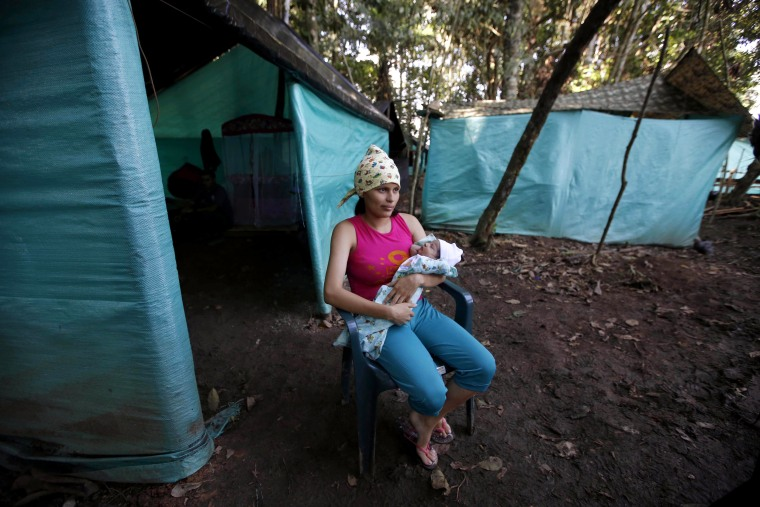 Image: FARC rebel Marly Velasquez holds her 18-day-old-daughter Andry Talia