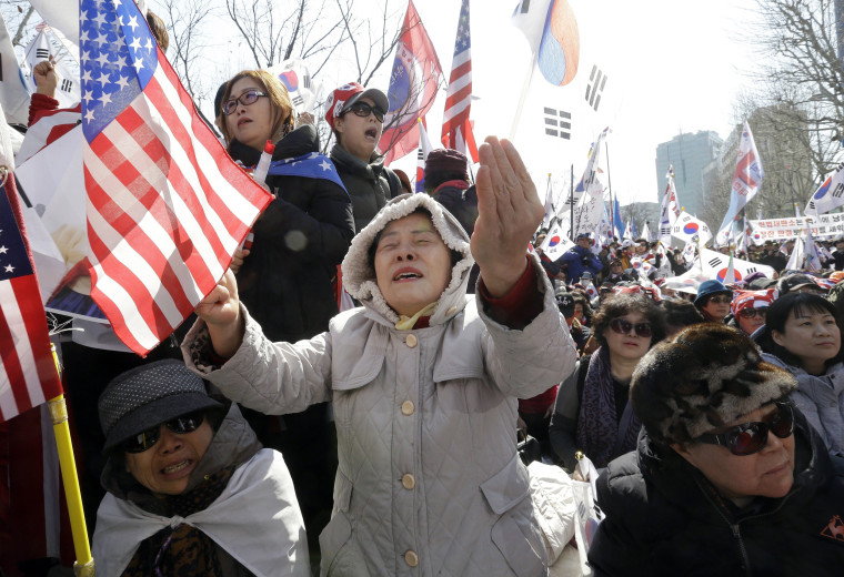 Image: Supporters of the president react during a rally opposing her impeachment near the Constitutional Court in Seoul.