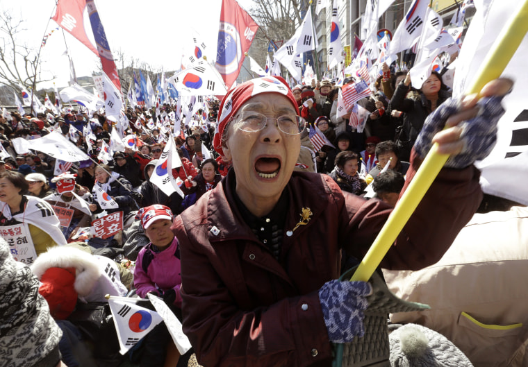 Image: A supporter of the South Korean president cries during a rally opposing her impeachment.