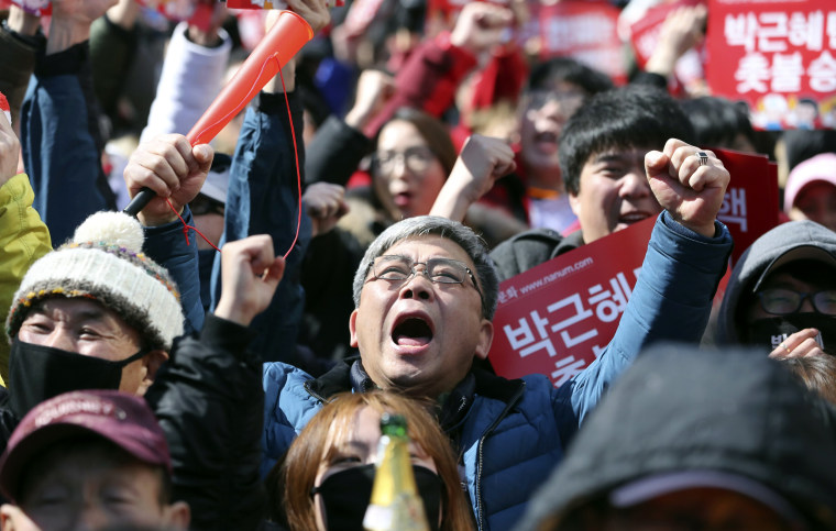 Image: Protesters react after hearing the Constitutional Court's verdict during a rally calling for the impeachment of President Park Geun-hye near the Constitutional Court in Seoul, South Korea, March 10, 2017.