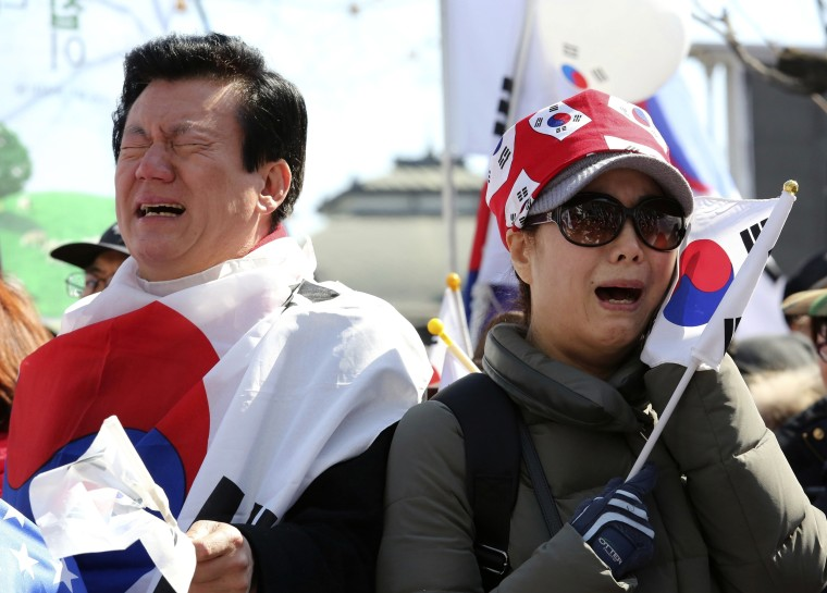 Image: Supporters of the president cry during a rally opposing her historical impeachment-- the first in South Korea's history.
