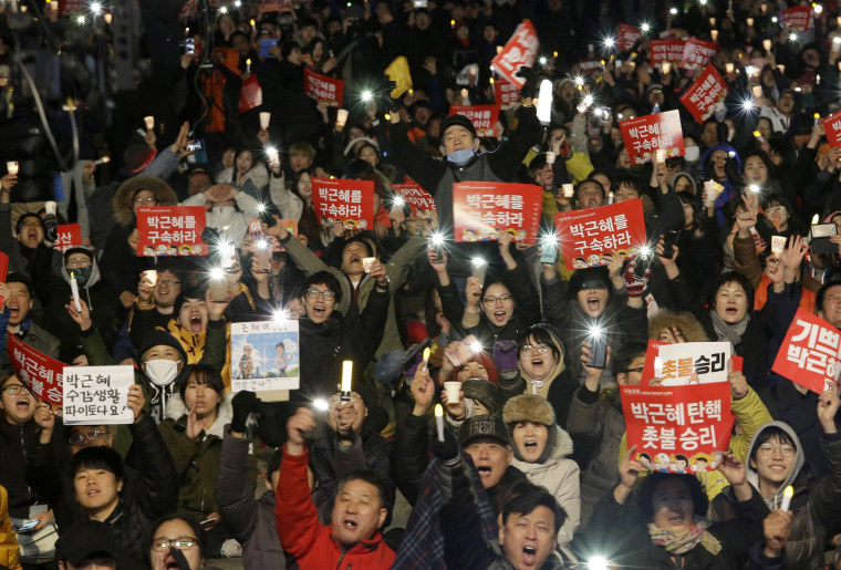 Image: Protesters shout slogans during a rally calling for impeached President Park Geun-hye's arrest.
