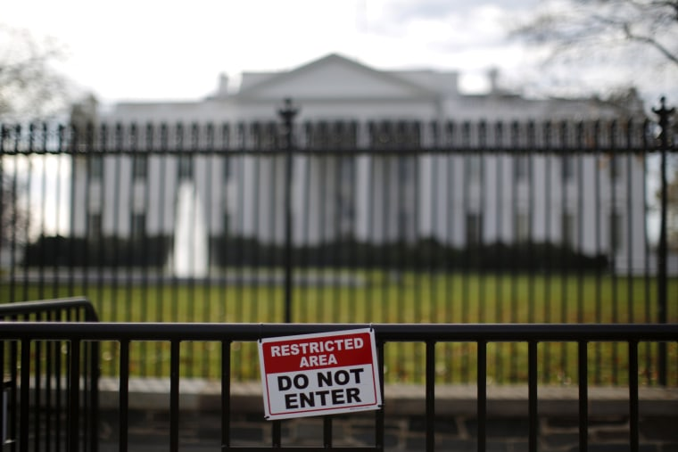 Image: FILE PHOTO: A restricted area sign is seen outside of the White House in Washington