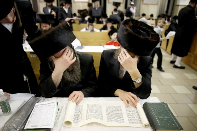 Image: Ultra-Orthodox Jewish men take part in the reading from the Book of Esther ceremony in a synagogue in Ashdod, Israel.