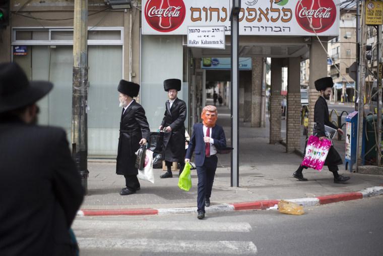 Image: An Ultra-Orthodox Jewish child wears a U.S. President Donald Trump mask and costume during the Purim festival in Bnei Brak, near Tel Aviv, Israel.