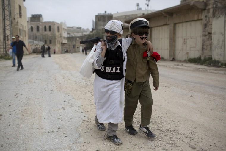 Image: Israelis take part in a Purim parade.