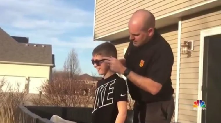 Aaron puts on Cayson's EnChroma glasses for the first time.