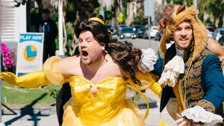 Corden makes a mad dash out of the street while dressed in his Belle costume.